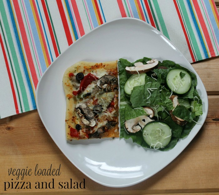 veggie loaded pizza and salad