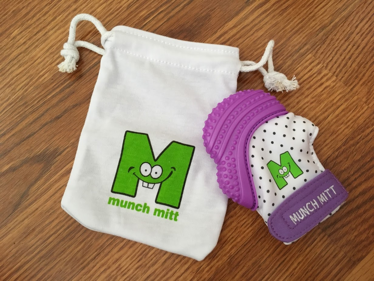 Munch Mitt Is The Teething Toy That Attaches Right To Baby
