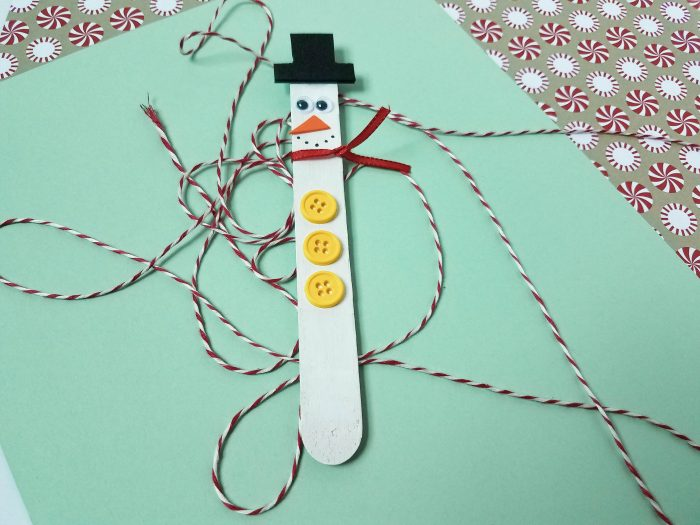snowman magnets made with crafts sticks