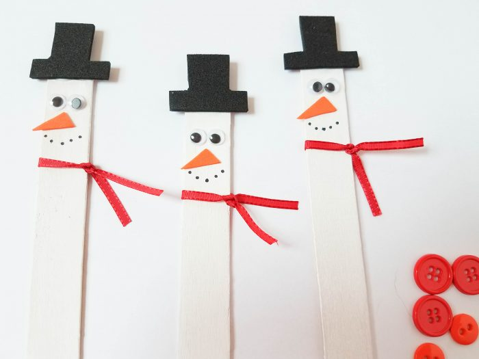 adding a scarf to snowman